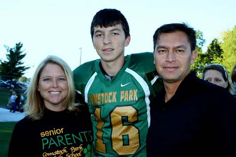 Comstock Park High School Grad Miguel Nava, who will be attending US Navy Academy, with his parents Lisa and Javier