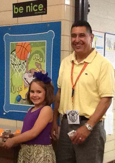 Watch DOGS volunteer Able Soto and granddaughter Kylie Soto, 6, wait in line for lunch