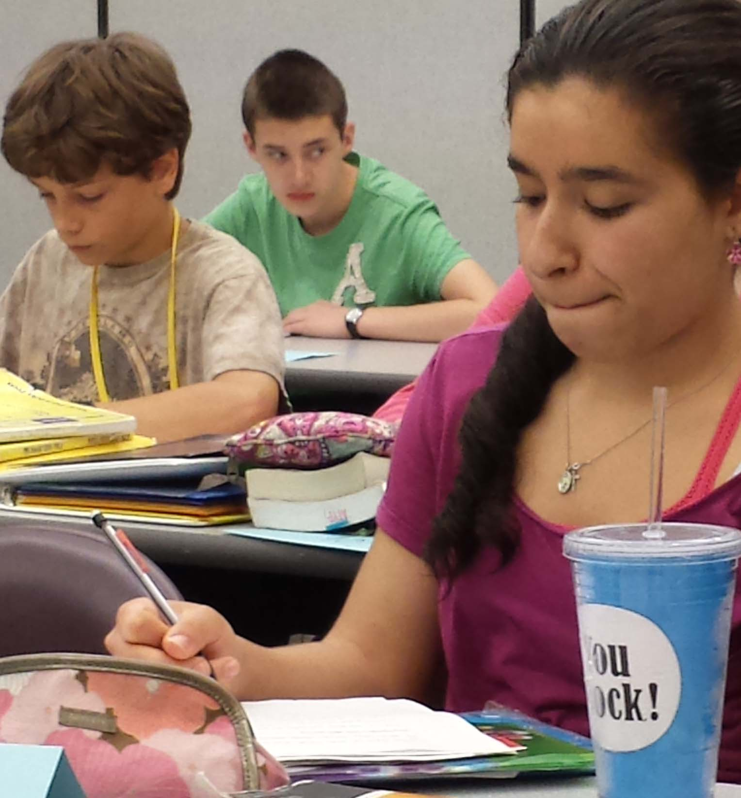 Graciela Aguillon concentrates while writing a short essay during her ATYP English language arts class