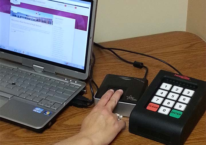 The biometric scanner uses data from measurements on each student's fingers to identify them