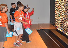 "Sixth grade students dance to create movement in front of artist Daniel Rozin's ArtPrize entry ""Trash Mirror"""