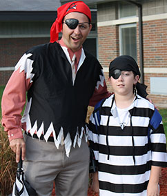 Michael Gelmi, principal at Page Elementary in Caledonia, joined in Talk Like a Pirate Day with student Gianni Perra