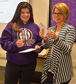 Caitlyn Bulthuis presents a check to Cheryl Molhoek, advancement director for 20 Liters
