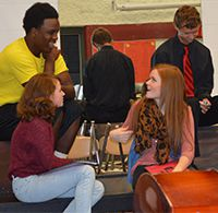 Tommy Brown chats during choir rehearsal with (from left) Elyse Underwood, Laurie Robinaugh and Austin Hendrick