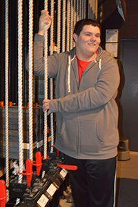 Senior Josh Hess works backstage during class