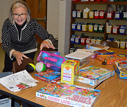 Gayle Bachert prepares for a Big Brothers Big Sisters meeting at Lee Elementary