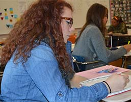Shelby Oleksy takes notes on essay writing for advanced-placement tests