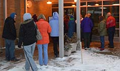 Parents line up at Zinser Elementary School, waiting for the bell before going inside and picking up their children