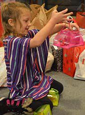 Lonnitta, a kindergartener at Cedar Trails, plays with a toy donated by her school