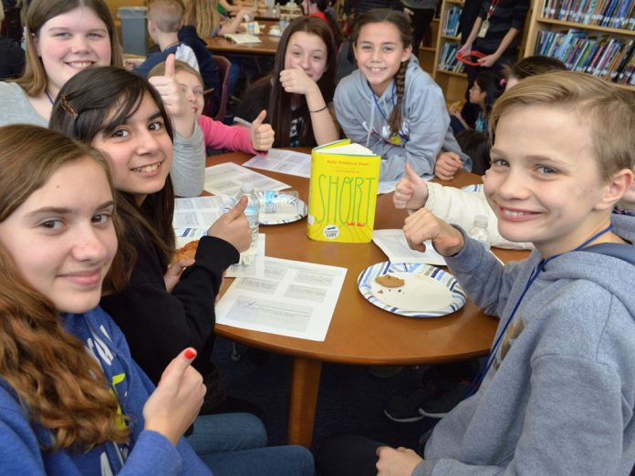 """This group of judges gave several thumbs-up to the novel """"Short"""" by Holly Goldberg Sloan. The book was selected for a Mock Newbery Honor by Lowell Middle students"""