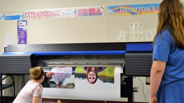Checking quality when blowing up pictures is key to being able to produce graduation open house banners