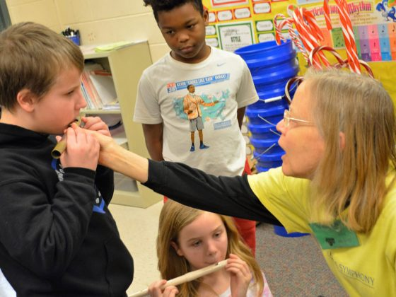 Judy Kemph, who plays piccolo and flute with the Grand Rapids Symphony, helps guide Jonathan Copsey