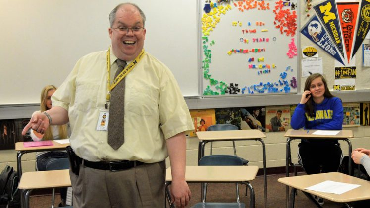 Kenowa Hills High school English teacher David Lyons says he thinks of his students as his children