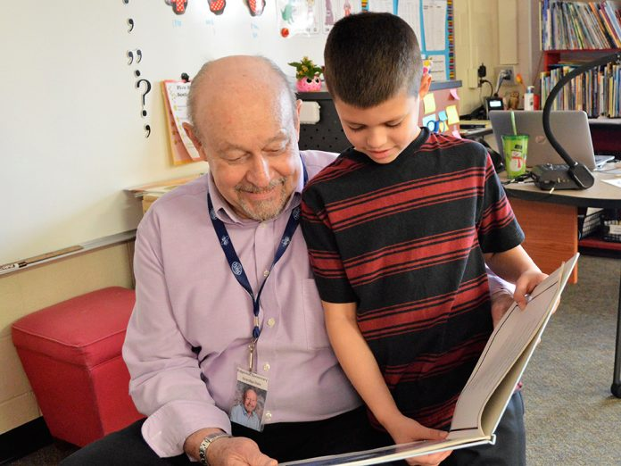 First-grader Jordan Eshraghi enjoys it when Grandpa Dale reads with him