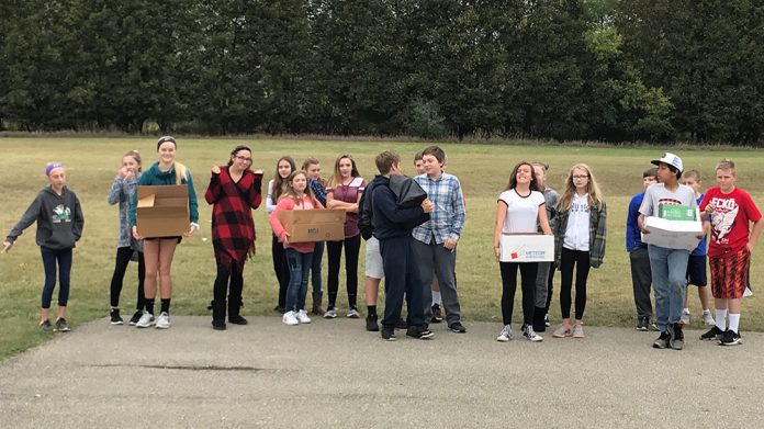 Social studies teacher Kyle Carhart's students carried boxes filled with textbooks this fall to simulate what it's like for their Sudanese counterparts to carry water every day
