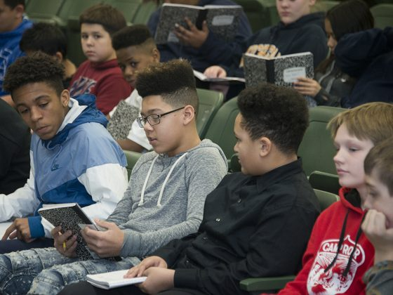Valleywood student Corey Mitchell reads his poetry to (from left) Amur Edwards Justin Day and Luke Allen