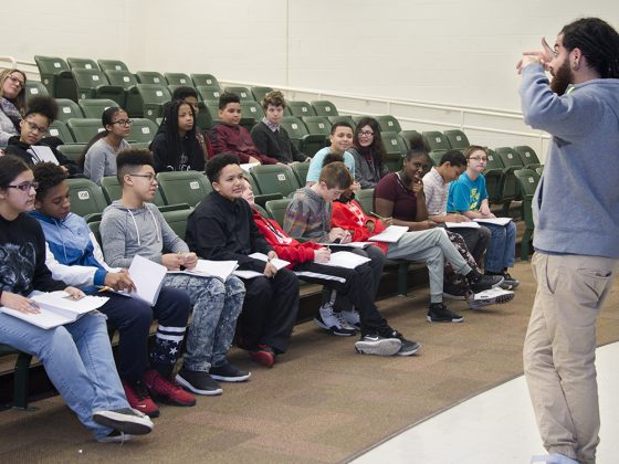 """Marcel Price, aka """"Fable the Poet,"""" speaks to Valleywood Middle School seventh-graders in a spoken-word poetry workshop run by The Diatribe"""