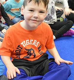 Kindergartner Sullivan Johnson rubs his legs, a calming technique taught through the Social Thinking curriculum