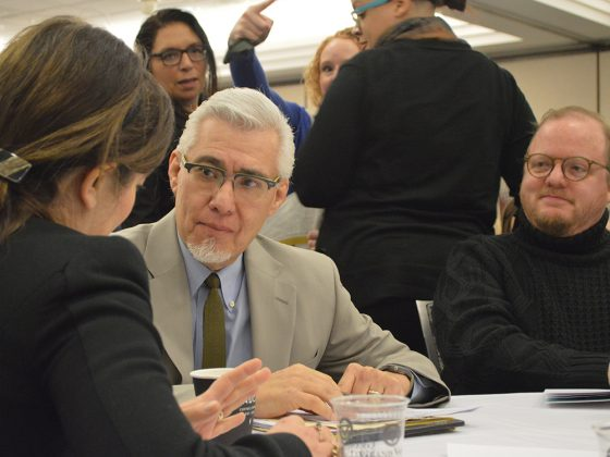 NPR education reporter Claudio Sanchez talks with Wendy Falb, left, executive director of the Literacy Center of West Michigan and GRPS Board of Education president