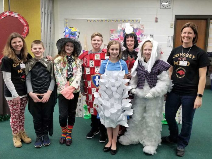 Members of the Cedar Springs Division II Odyssey of the Mind team are, from left, parent coach Traci Slager, seventh-grader Aiden Lake, sixth-graders Annalise Elliott, Brielle Sarniak, Nate Slager and Coryn Wiles, eighth-grader Jade Yowtz, and long-term coach Michelle Wiles