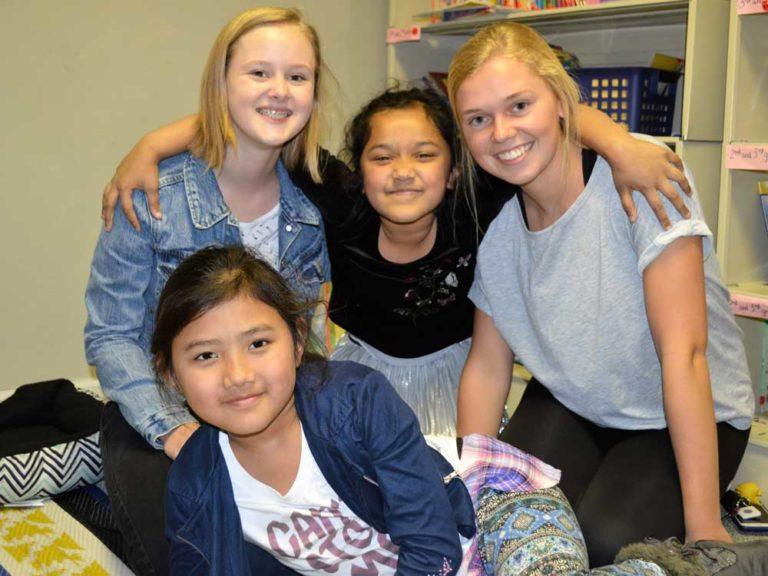 Students help refugee peers adjust to life, schools in the U.S.