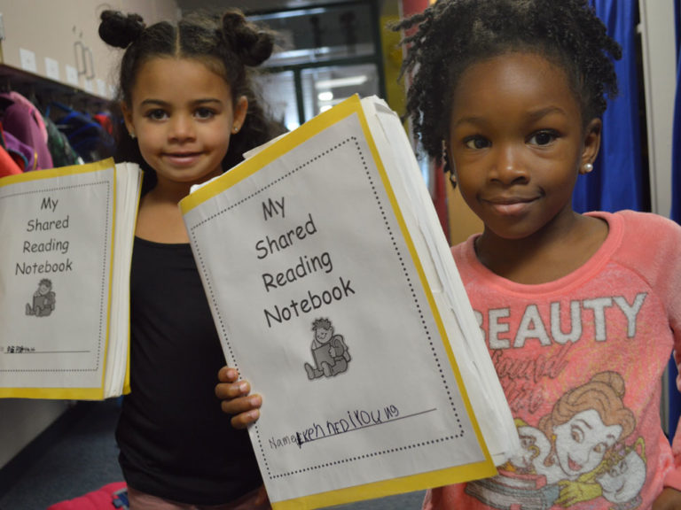 Kindergartners use notebooks to share reading with their families