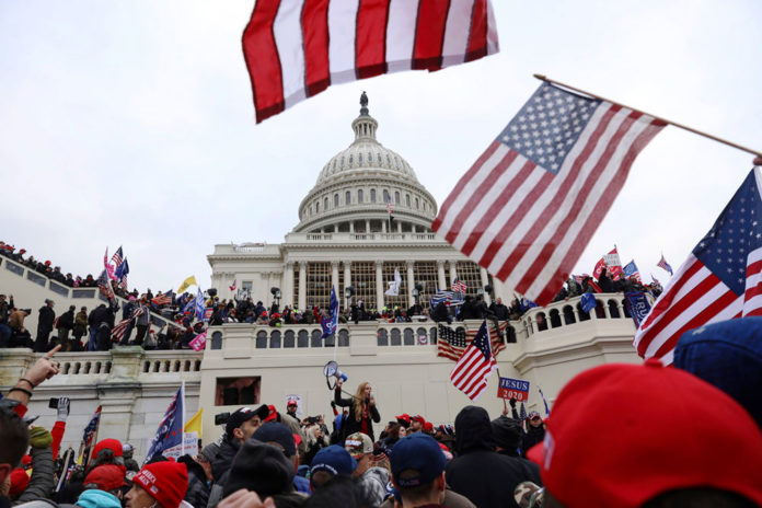 Protestors turn into violent mob at the U.S. Capitol, Wednesday, Jan. 6, 2021, in Washington. (AP Photo/Shafkat Anowar)